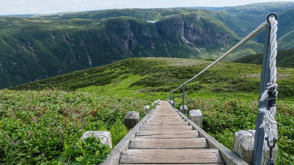 Set of stairs and rope handle leading down Gros Morne Mountain