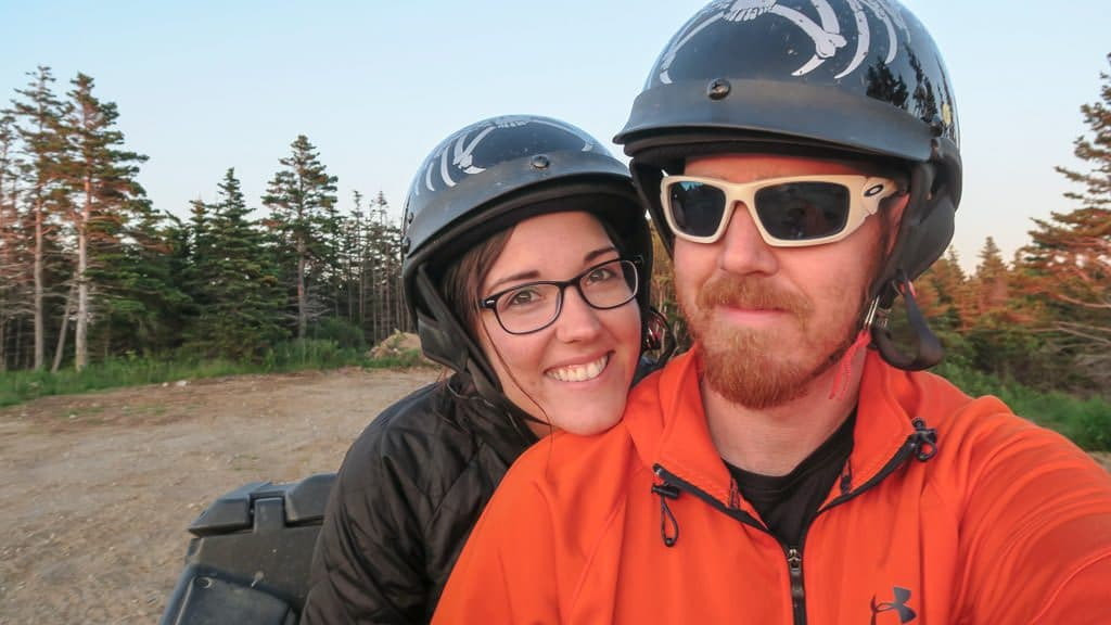 Brooke and Buddy with their helmets on during their mini ATV Adventure in Newfoundland