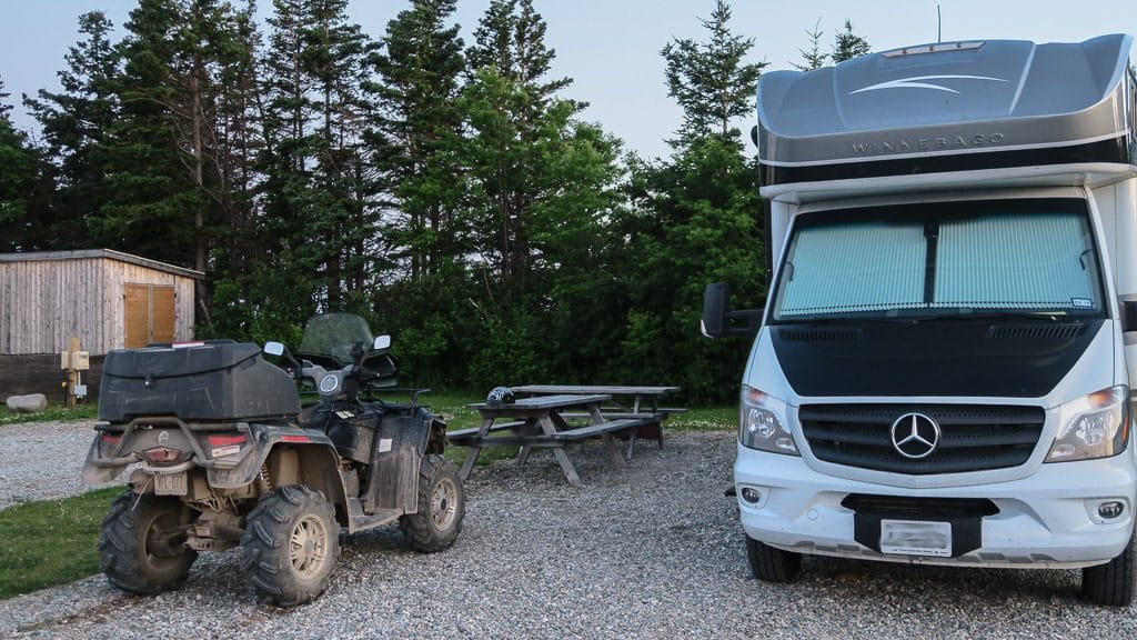 Our Winnebago View with an ATV parked out front for our sunset adventures