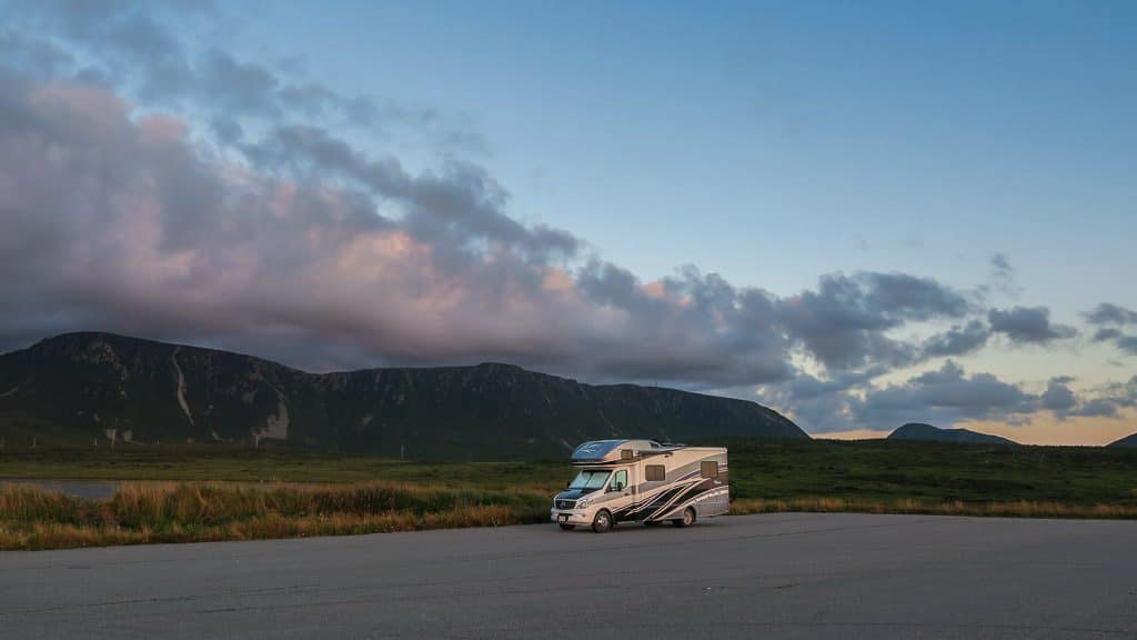 Vik the View in a gravel parking area at sunset the night before we were set to leave Newfoundland and head back to Nova Scotia