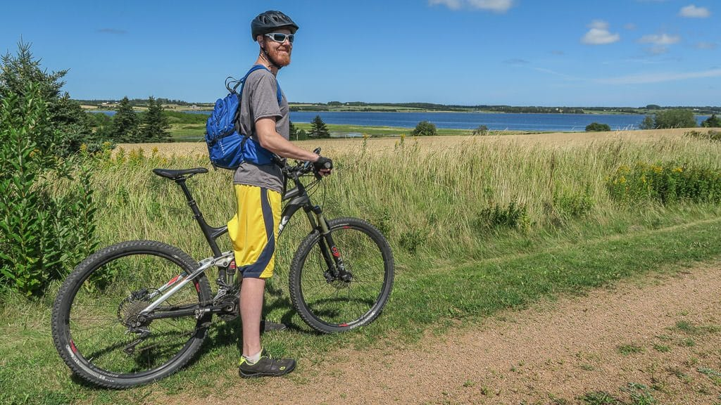 Buddy taking in the views with his bike while cycling part of the Confederation Trail