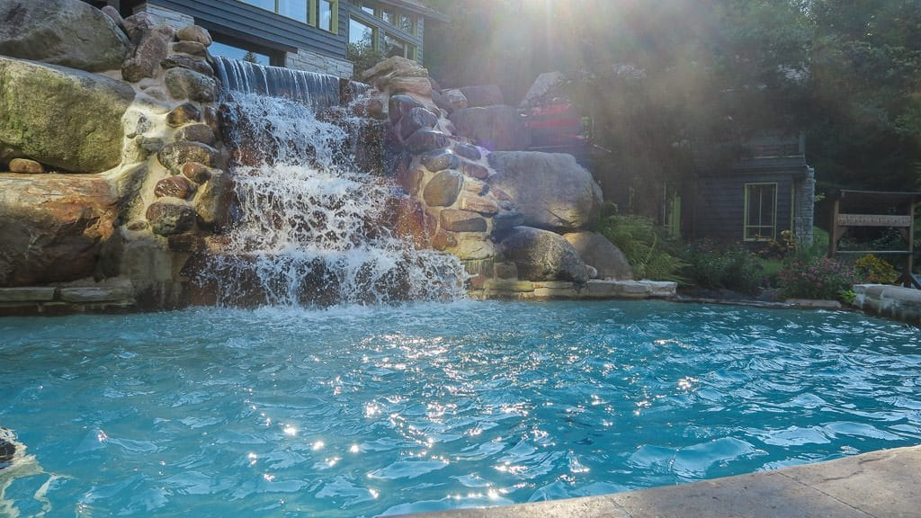 One of the warm pools with a nice waterfall feature to aid in the relaxing atmosphere at scandinave spa in mont-tremblant