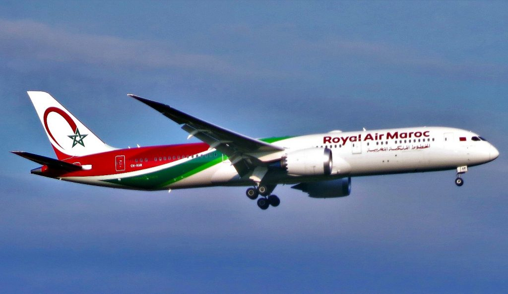 Airliner painted red, green and white with green star on tail