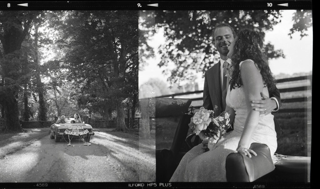 wedding portrait with classic car on black and white film