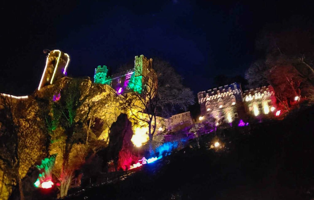 rhine river castle lit up for christmas in germany