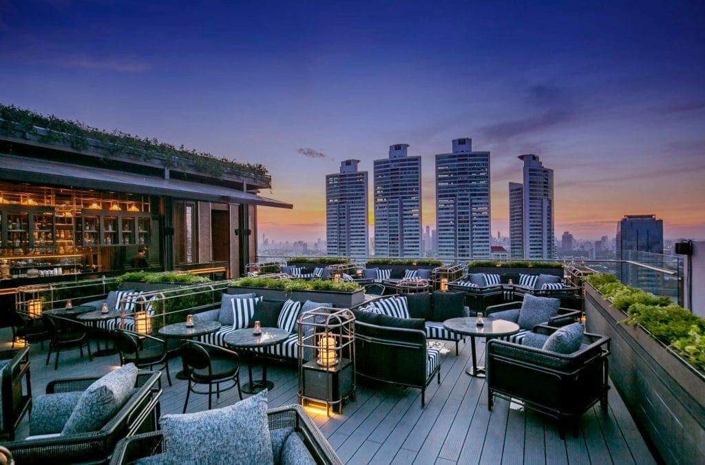 Roodftop bar with Bangkok skyline in background