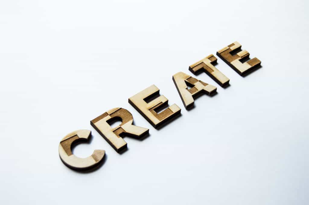 the word create made out of wood