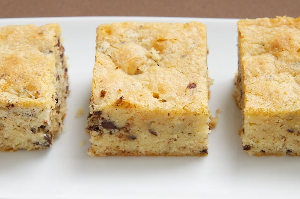 side view of White Chocolate Brownies on a white tray