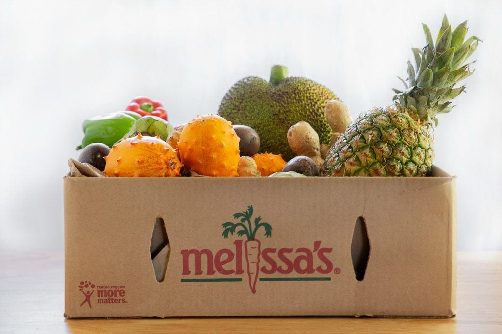 "cardboard crate filled with exotic fruits and priinted with ""melissa's Produce"""