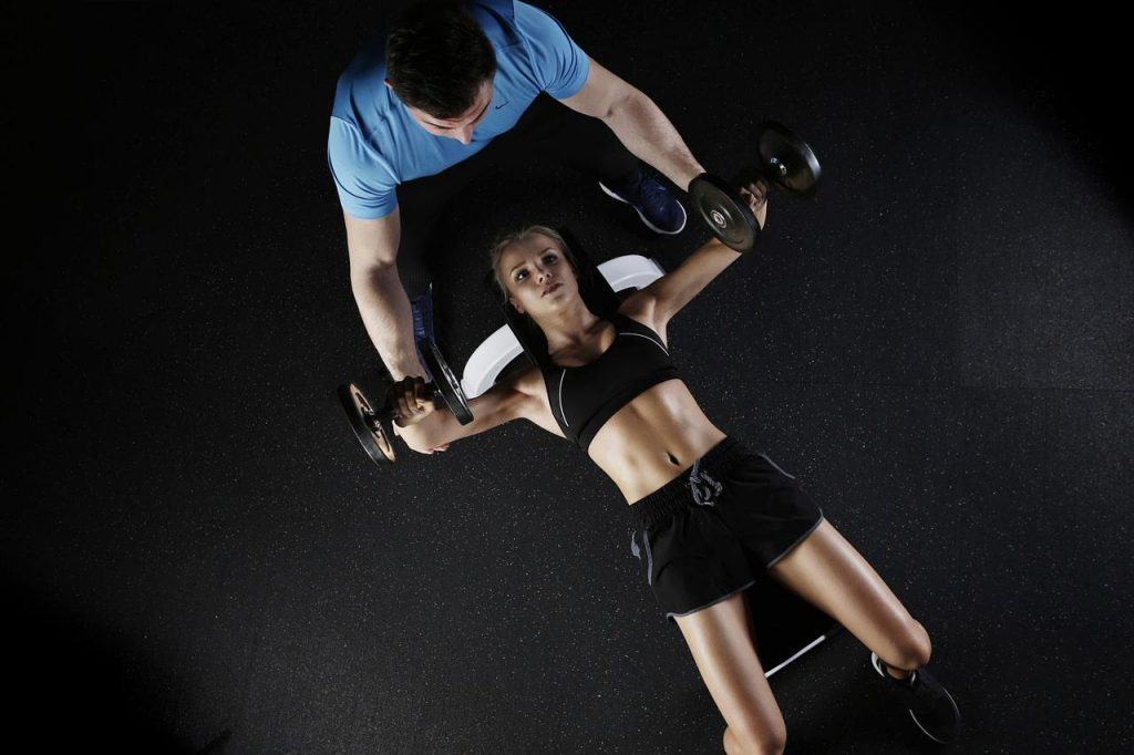 girl with personal trainer