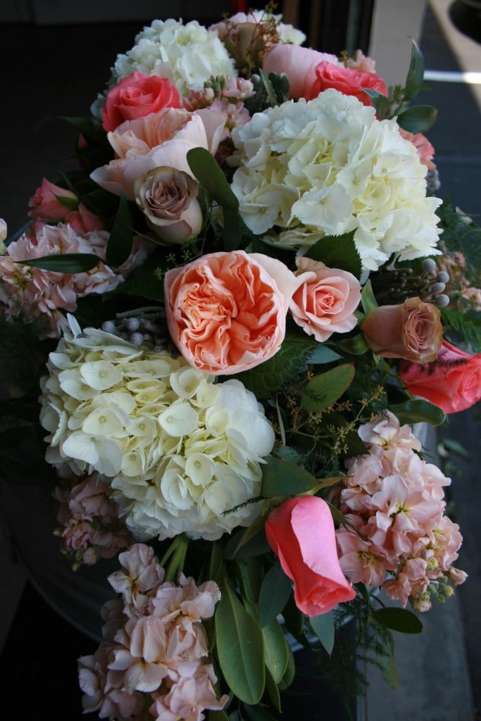 Arch Flowers. peach, ivory, coral, grey and brown.