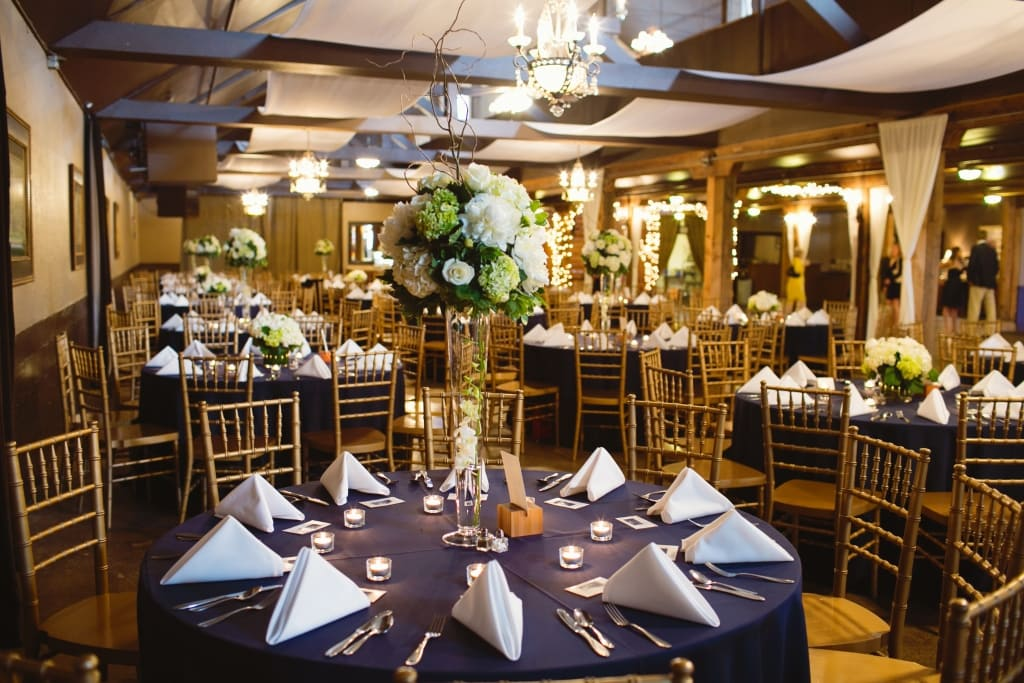 Tall trumpet vase centerpieces. White centerpieces peonies, hydrangea, dendrobium orchids, curly willow, green hydrangea.