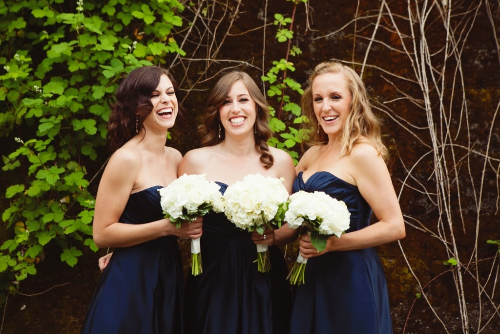Navy and white classic wedding. Bridesmaid bouquet of white hydrangea, roses, and dahlias.