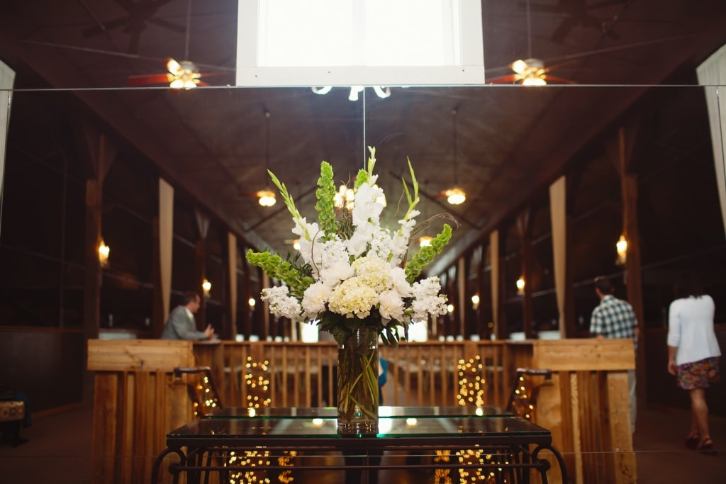 Altar flowers. Bells of ireland, glads, peonies, hydrangea, stock. White and green.