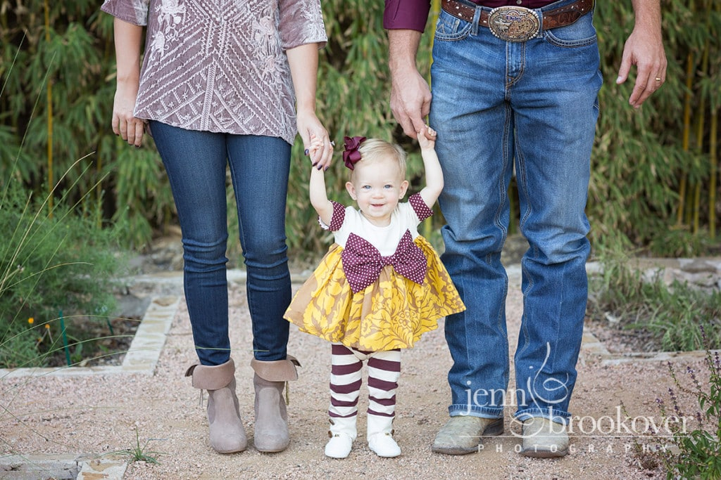 close up of one year old girl in maroon outfit taken at Landa Library during photo session