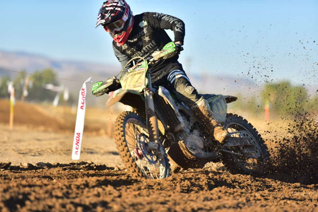Blayne Thompson throwing roost on his PC Kawasaki at the 2019 Ridgecrest NGPC
