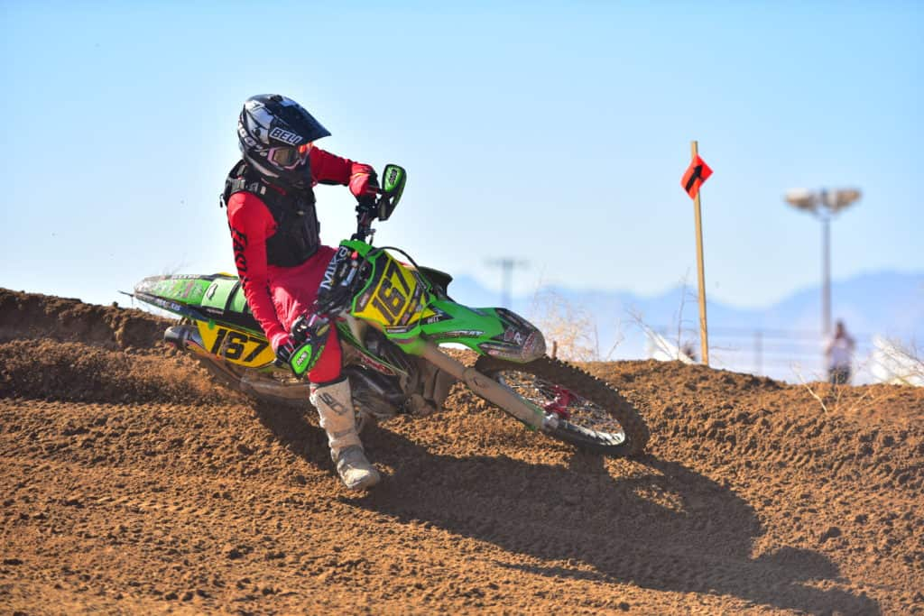 Zach Bell turning on his PC Kawasaki on a berm at the 2019 Ridgecrest NGPC