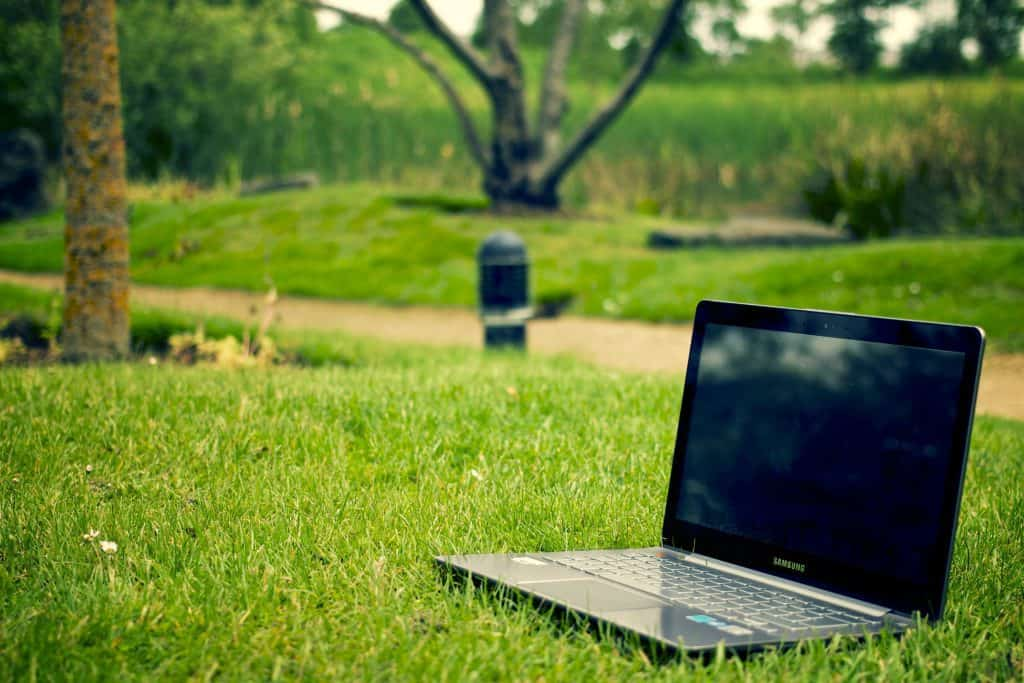 digital marketing laptop on grass as we focus on the regional aspect of computer support