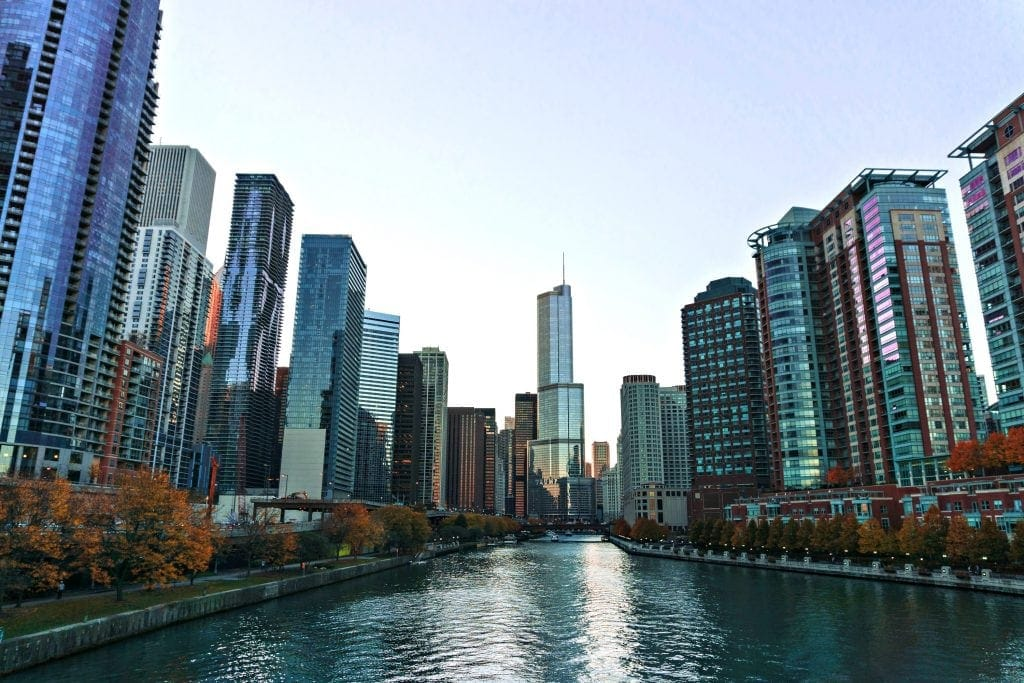 Chicago skyline dwarfs Chicago River. Photo taken near water level - urban kayaking Chicago