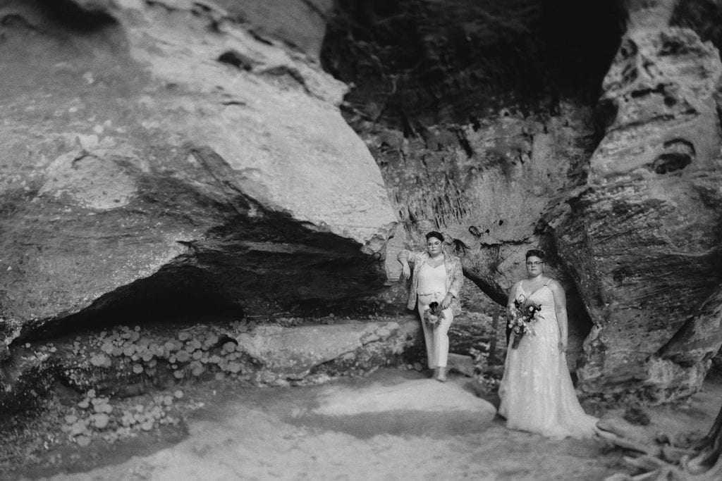 queer wedding portrait black and white with rock formations