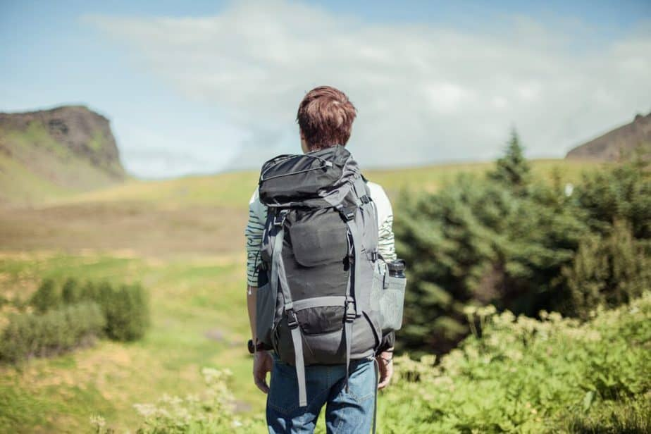 A boy is carrying a backpack for cardio exercise.