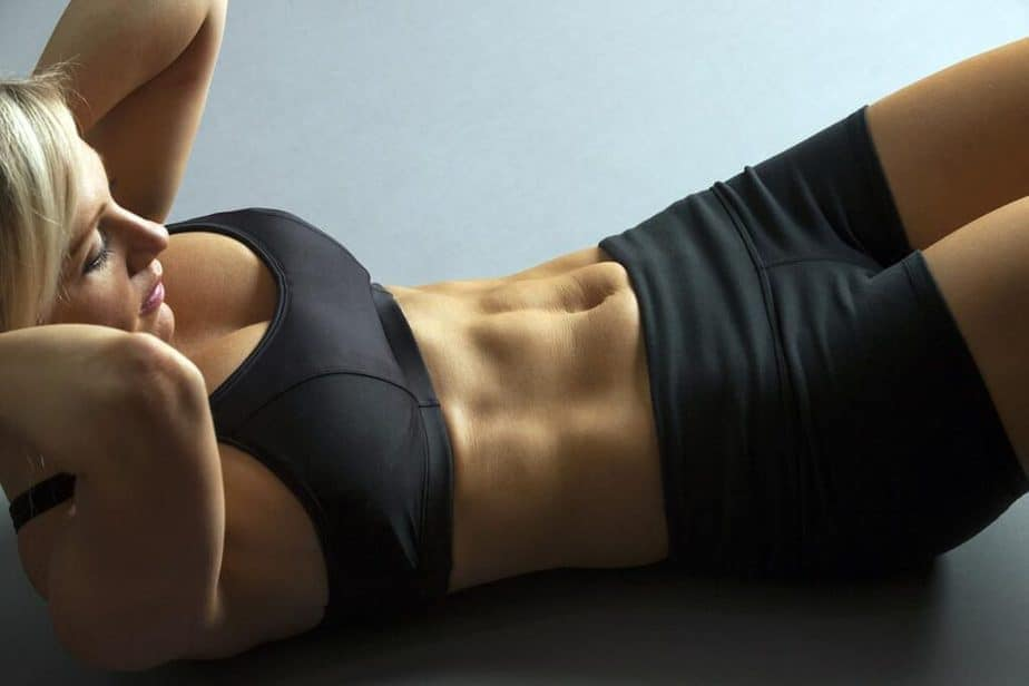 A girl is doing exercise for flat stomach.