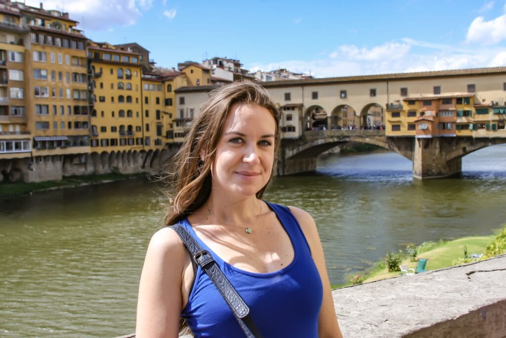 Melanie May Content Creator by a bridge in Florence, Italy