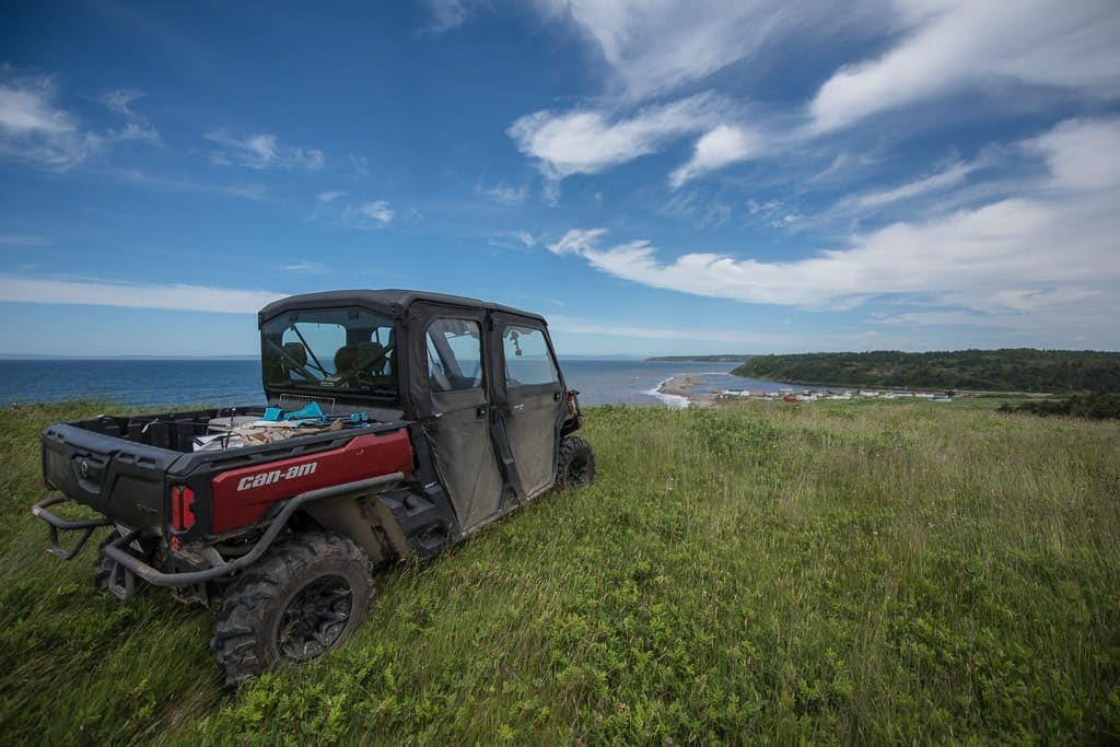 ATV in the grass on a cliff overlooking the ocean at Pirate's Haven Newfoundland ATV tour in Newfoundland