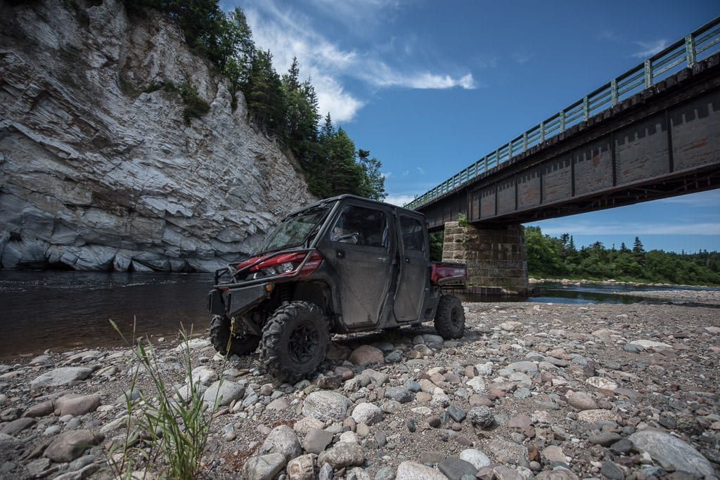 ATV next to the river on our ATV Adventure in Newfoundland