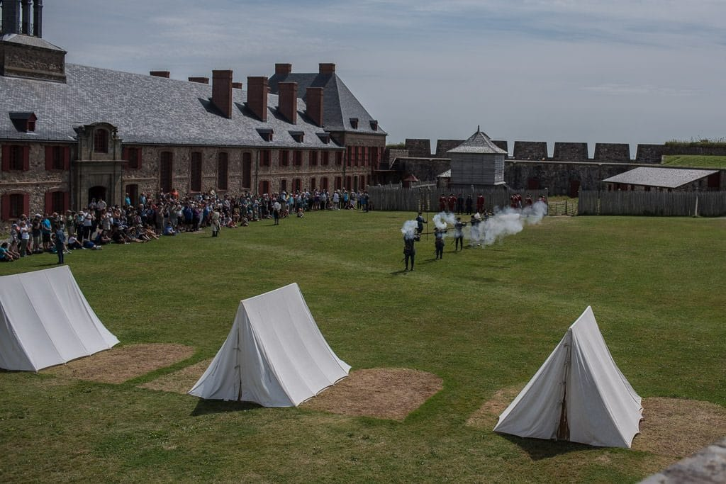 firing of the muskets in the field during the military pageantry at Fortress of Louisbourg