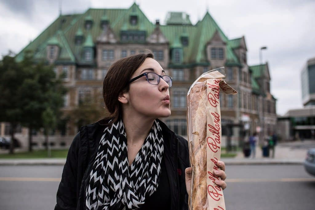 Brooke pretending to kiss the giant baguette that we got on the way back to our RV.