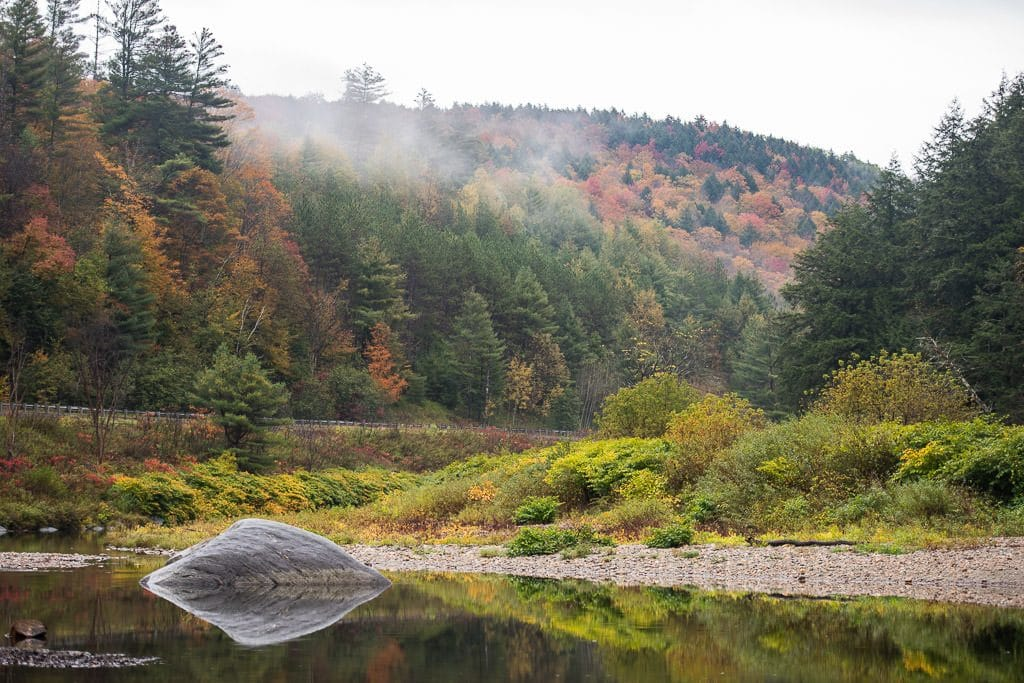 River with fog coming in over the Vermont fall foliage during our Vermont Road Trip