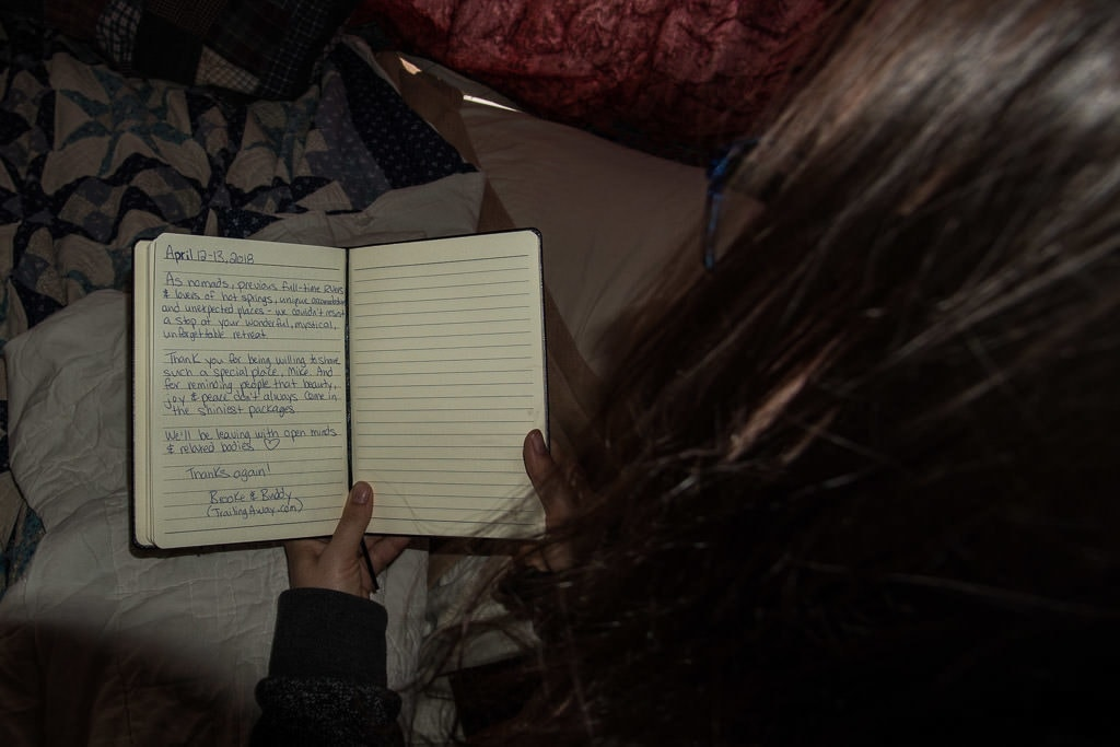 Brooke rereading our entry into the guestbook in The Ripple at Mystic Hot Springs