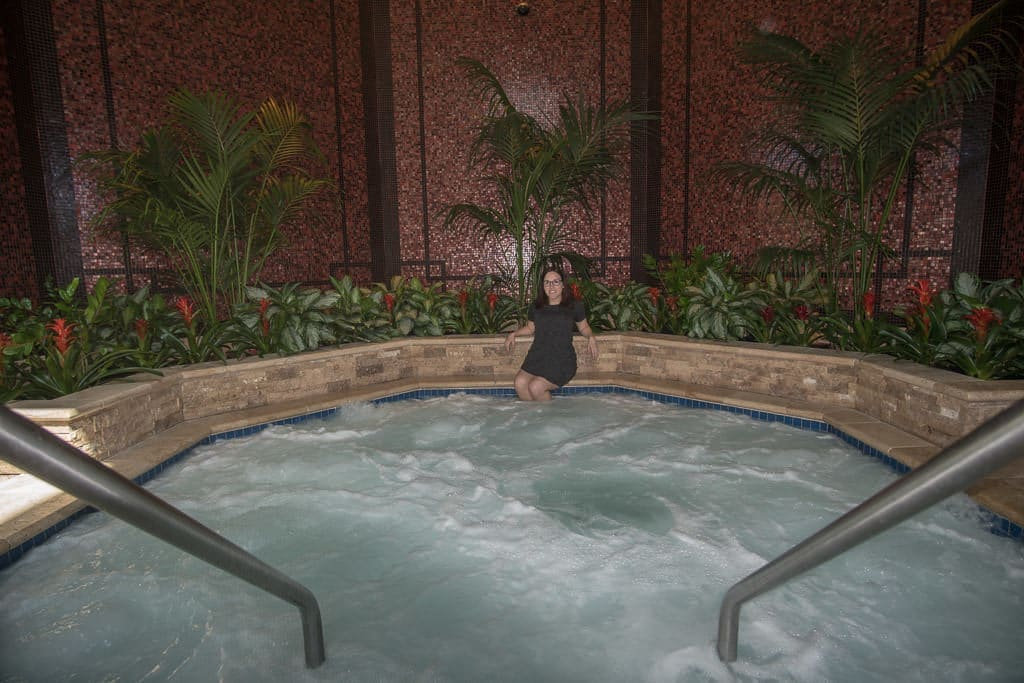 Brooke with her feet in the large indoor hot tub on the roof of Ameristar Black Hawk Resort
