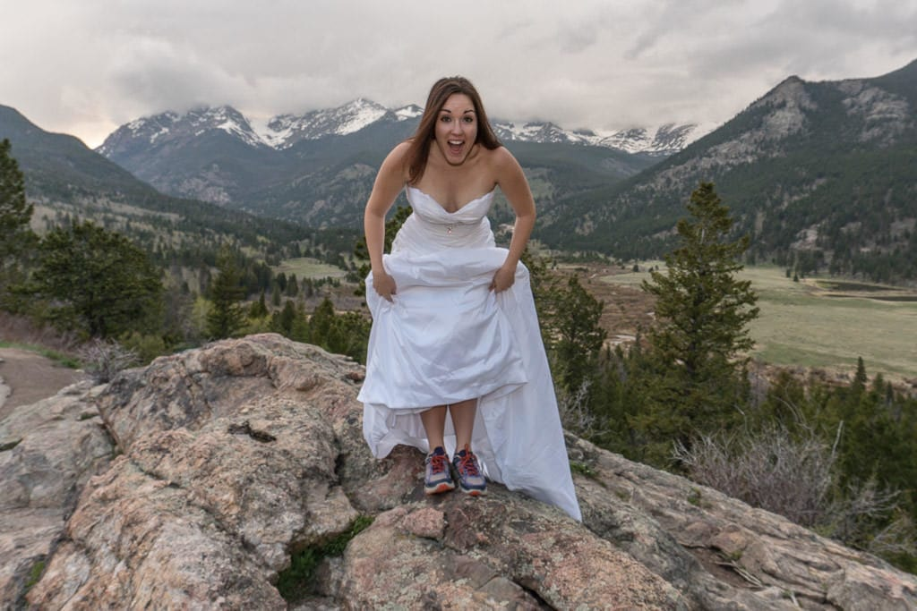 bride with hiking shoes for rocky mountain vow renewal photo