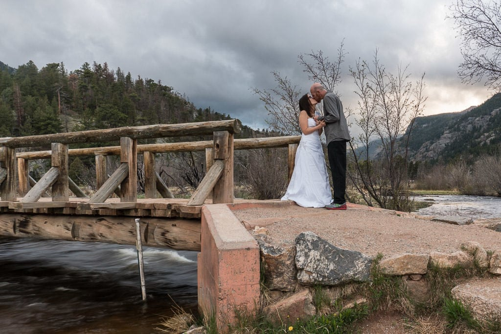 kissing during rocky mountain vow renewal
