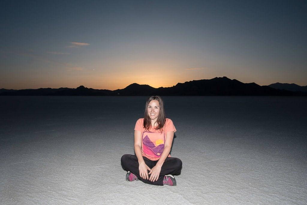 Brooke sitting on the salt at Bonneville Salt Flats during sunset
