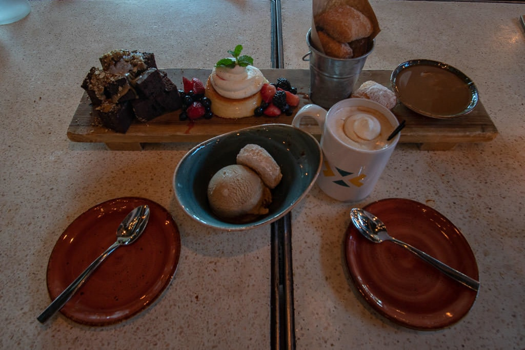 Amazing desert spread from Kachina Southwestern Grill including Flan, beignets, ice cream, brownies