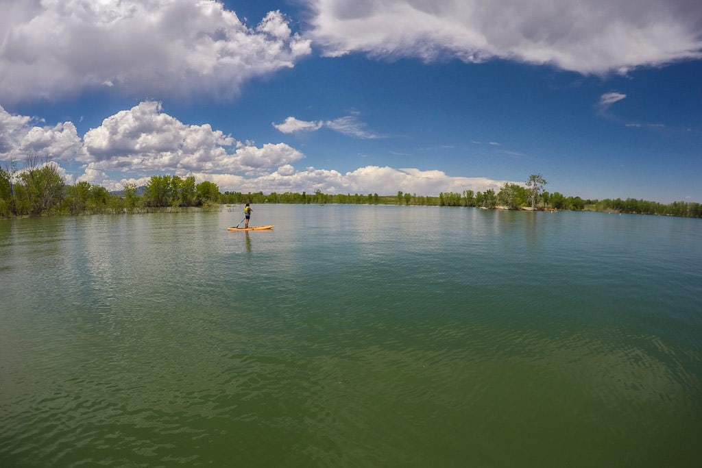 Brooke paddleboarding on the flat waters of standley lake
