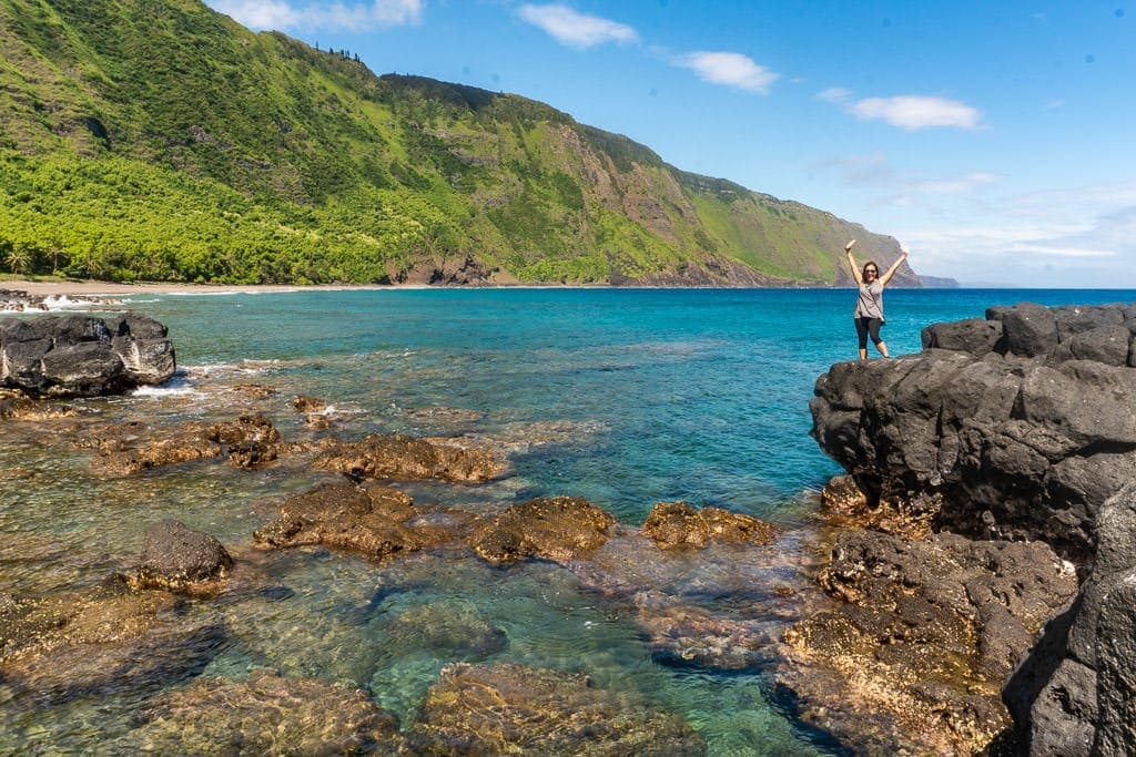 Brooke at rocky beach after Hiking down to Kalaupapa in Molokai