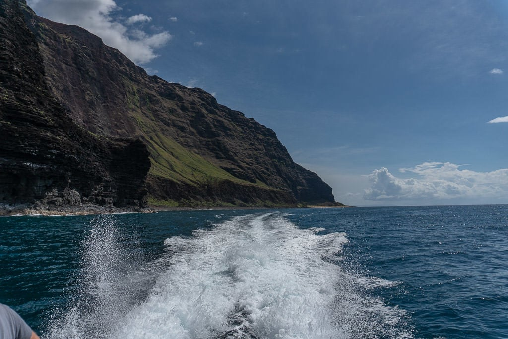 speeding away on napali coast boat tour in Kauai
