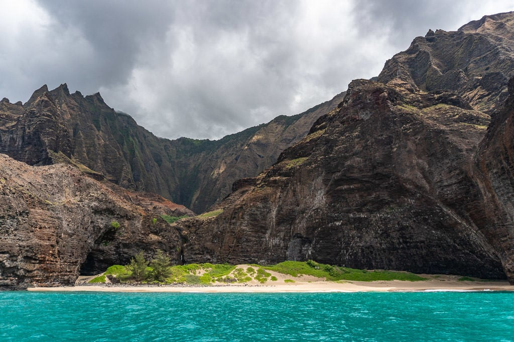 blue waters and napali coast cliffs in kauai