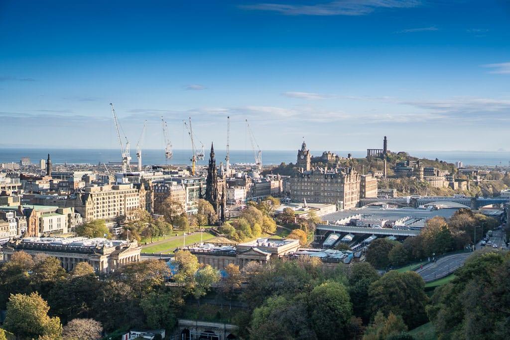 calton hill views of Edinburgh Scotland with cranes and castle