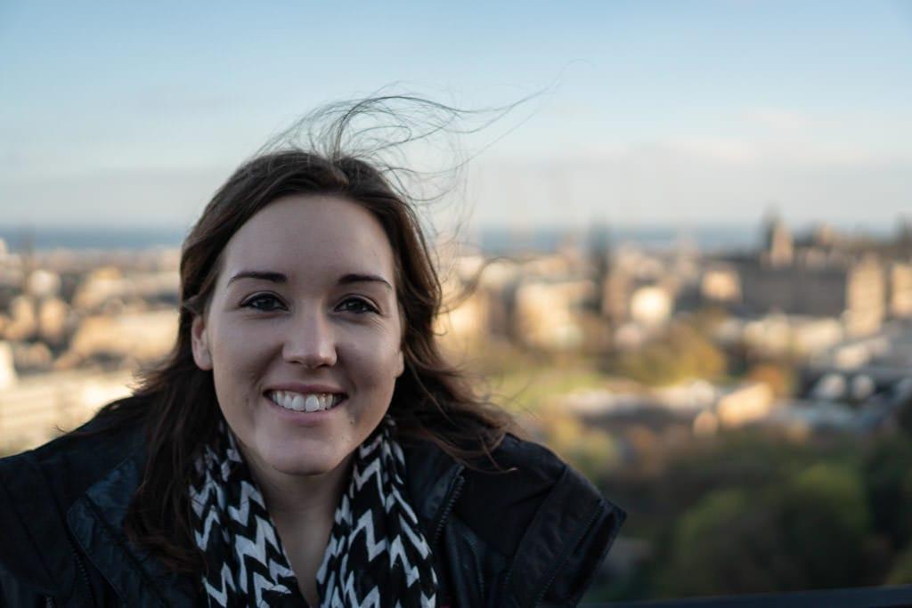 brooke with calton hill views of Edinburgh Scotland during our weekend in Edinburgh