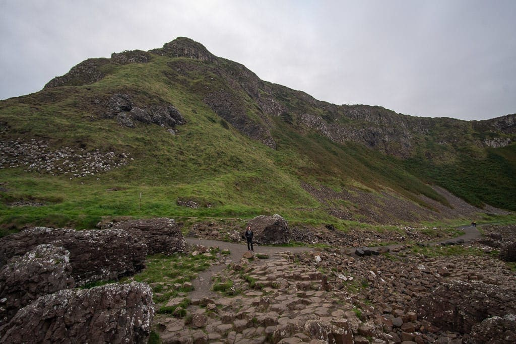 Brooke walking around giants causeway in Northern Ireland during our 5-day Ireland road trip