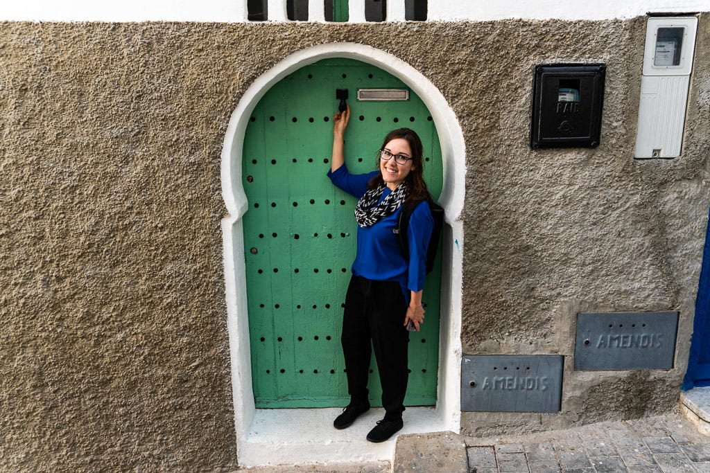 admiring a colorful door in tangier on a day trip to Morocco