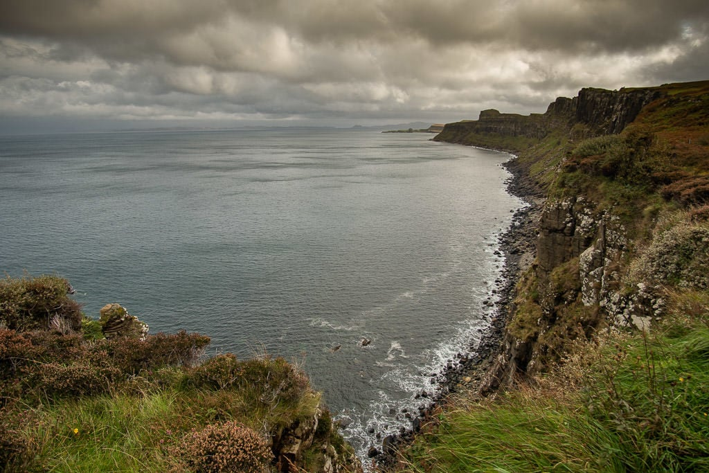 Kilt Rock and Mealt Falls overlook looking down the stunning coast on a cloudy day