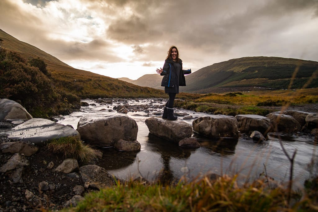Brooke standing on some rocks at the Fairy Pools where we needed to cross over a river