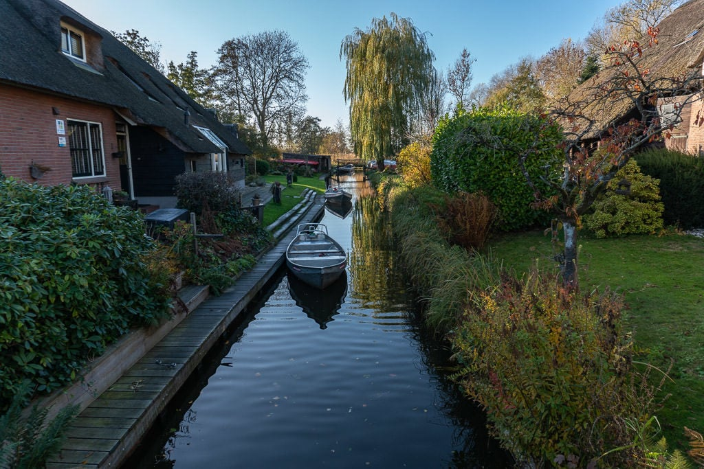 house with boat on canal in giethoorne on day trips from amsterdam