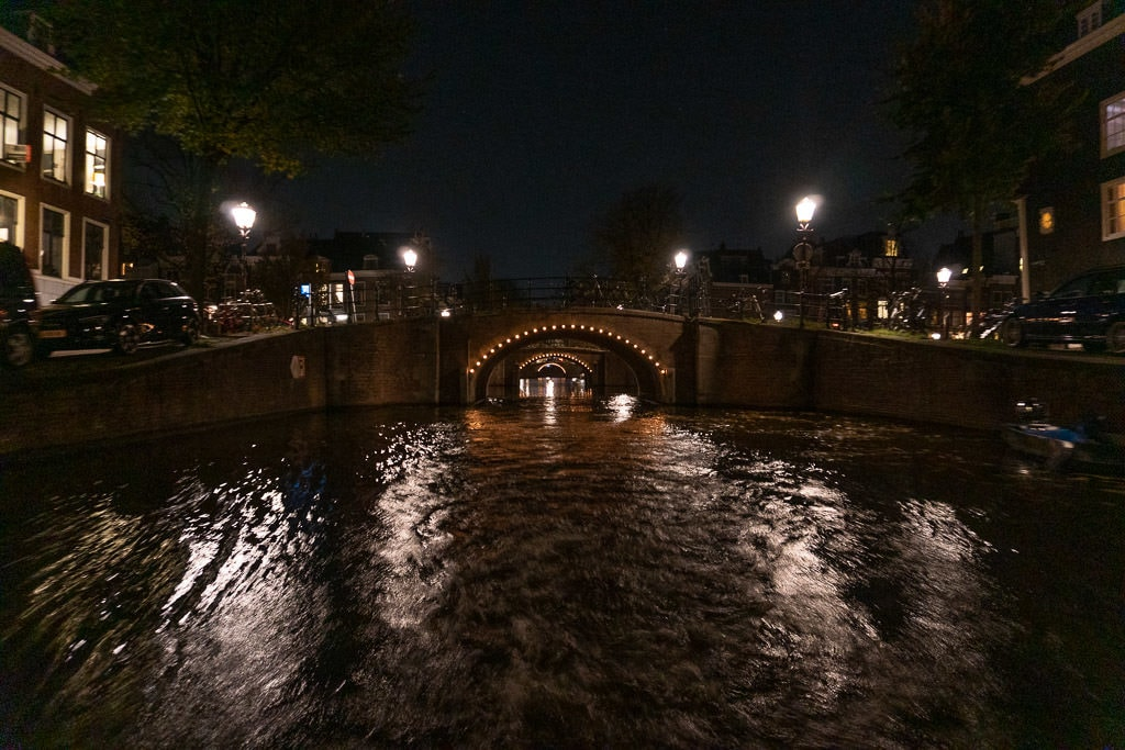 amsterdam canals lit up at night during our Blue Boat Amsterdam Evening Cruise